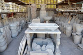 Collection of objects found during excavations in ancient Pompeii — Stock Photo