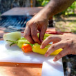 Cooking peppers and onions — Stock Photo