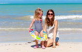 Mom daughter beach fun — Stock Photo