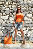 The girl with the orange bag. — Stock Photo
