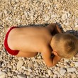 The little boy fell asleep on the beach. — Stock Photo #28596059