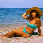 Woman sunbathing on the beach. — Stock Photo #29195833