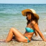 Woman sunbathing on the beach. — Stock Photo #29195841