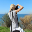 Girl photographing the landscape. — Stock Photo #32618197