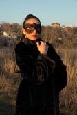 Menina linda em uma máscara — Fotografia Stock