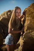 Girl among the rocks on the nature — Stock Photo