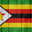 Royalty-Free Stock Photo: Wooden fence with the flag of Zimbabwe painted on it