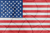 The flag of the United States of America painted on a cracked desert floor — Stock Photo