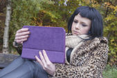 Alternative Model sat on Bench with Tablet PC — Photo