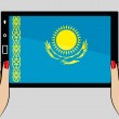 Tablet computer with the flag of Kazakhstan — Stock Vector #51234773