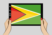 Tablet computer with the flag of  Guyana — Stock Vector