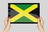 Tablet computer with the flag of Jamaica — Stok Vektör