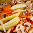 Stock Photo: Raw vegetables, onions, carrots, bell peppers, mushrooms,