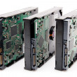 Three computer harddrives with circuit board - Stock Photo