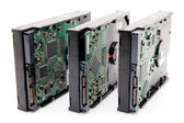 Three computer harddrives with circuit board — Stock Photo