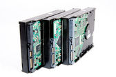 Bunch of computer harddrive with circuit board — Stock Photo
