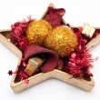 Star shaped dish with christmas bubble and christmas decoration - Stock Photo