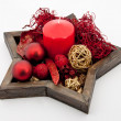 Star shaped dish with christmas bauble, red candle and christmas decoration — Stock Photo