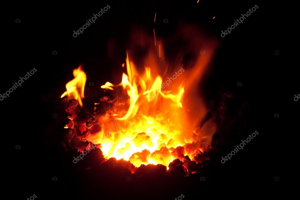 Flames of a fire of a smith in the dark  Stock Photo #13749584