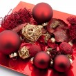Royalty-Free Stock Photo: Red dish with christmas balls and christmas decoration isolated on white ba