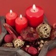 Star shaped dish with red candles and christmas decoration — Stock Photo #13750425