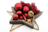 Star shaped / round silver dish with christmas bauble / red candles and chr — Stock Photo