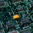 Stock Photo: Infromation technology computer board with yellow transistor
