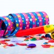 Noisemakers for a party isolated on white background with air streamers and — Stock Photo