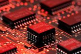 Infromation technology computer board with transistor and red light — Stock Photo