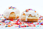 Donuts for a party isolated on white background with confetti — Stock Photo