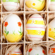 Stock Photo: Assorted colorful painted easter eggs in wooden box