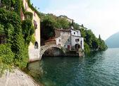Old bridge on the lake — Stock Photo