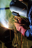 Welding worker doing welding at pipe — Stock Photo