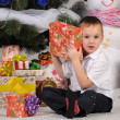 Royalty-Free Stock Photo: Boy and gifts in Christmas