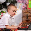 Royalty-Free Stock Photo: Boy and laptop in Christmas