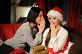 Two women in Christmas night at home — Stock Photo
