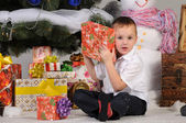 Boy and gifts in Christmas — Stock Photo