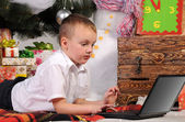 Boy and laptop in Christmas — Stock Photo