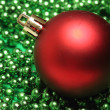 Big red ball over green small balls — Stock Photo #16621865