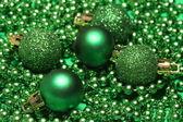 Five green christmas balls — Stockfoto