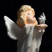 Christmas angel with star over black — Stock Photo