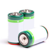 Three batteries on white — Stock Photo
