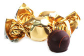 Chocolate candy in golden wrapper — Stock Photo