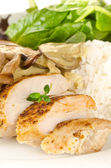 Fried spiced chicken breast cutted and served with creamy muchroom sauce, rice and salad — Stock Photo