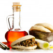 Flask of Chili oil with chinese hamburger and chopsticks - Stock Photo