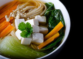 Miso soup with noodles, tofu, enoki and bok choy in a bowl — Stock Photo
