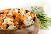 Roasted pumpkin with blue cheese, cashew nuts and rosmary — Stock Photo
