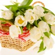A bunch of beautiful white tulips in the basket isolated on whit — Stock Photo