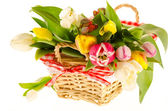 A bunch of colorful tulips in the basket isolated on white — Stock Photo