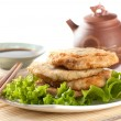 Fried chinese pancakes served with salad leaves with tea and cho - Stock Photo